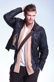Smiling young casual man in leather jacket Stock Images
