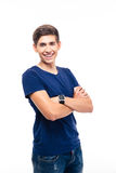 Smiling young casual man standing with arms folded Royalty Free Stock Photo