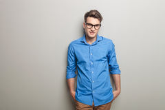 Smiling young casual man wearing glasses Stock Images