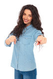 Smiling young casual woman pointing fingers Stock Photos