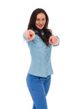 Smiling young casual woman pointing fingers Royalty Free Stock Photography