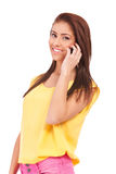 Smiling young casual woman speaking on phone Stock Photo