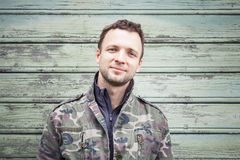 Smiling young Caucasian man in camouflage Royalty Free Stock Photo