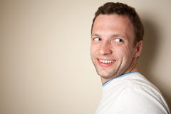 Smiling young Caucasian man in white t-shirt Royalty Free Stock Photography