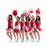 Smiling young cheerleaders posing against white Royalty Free Stock Image