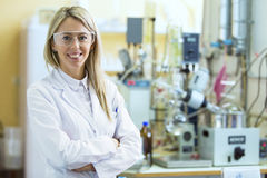 Smiling young chemist in chemistry lab Stock Photography