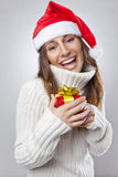 Smiling young Christmas woman with Santa hat royalty free stock photos