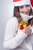 Smiling young Christmas woman with Santa hat stock photos