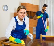 Free Smiling Young Cleaners Cleaning And Dusting Royalty Free Stock Photos - 64128098