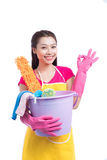 Smiling young cleaning asian lady with pink rubber gloves showing ok sign with thumbs up over white stock photography