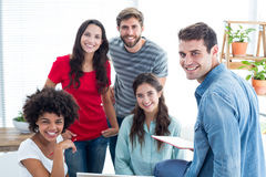 Smiling young colleagues in office Stock Photo