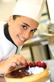 Smiling young confectioner Stock Image