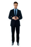 Smiling young confident executive. Confident executive standing in business suit isolated on white background Stock Photo