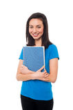 Smiling young confident student holding notebook Stock Photo
