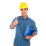 Smiling young construcion engineer making the ok sign Royalty Free Stock Photography