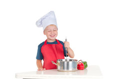 Smiling young cook Stock Photos