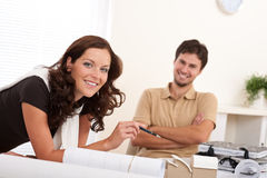 Smiling young couple with architectural model Royalty Free Stock Images