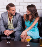 Smiling young couple in a bar. Having fun together Stock Photography