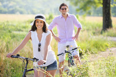 Smiling young couple with bicycles Stock Image