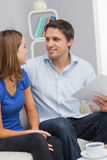 Smiling young couple with bills at home Stock Photo