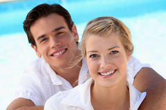 Smiling young couple. With a blue sky background royalty free stock photo