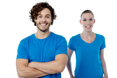 Smiling young couple in casuals Stock Images