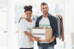 Smiling young couple with clothes donation Stock Images