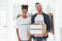 Smiling young couple with clothes donation Royalty Free Stock Photo