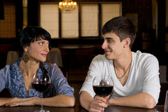 Smiling young couple on a date out drinking royalty free stock photography