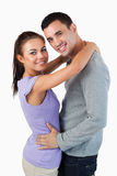 Smiling young couple embracing Stock Images