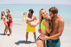 Smiling young couple embracing at beach Royalty Free Stock Photo