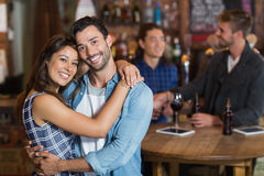 Smiling young couple embracing Stock Image
