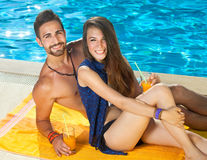 Smiling young couple enjoying a day at the pool. Royalty Free Stock Photos