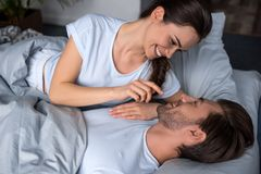 Smiling young couple fooling around. In bed Stock Photo