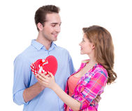 Smiling young couple with a gift. Stock Photos