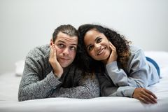 Smiling Young couple in grey sweater looking up royalty free stock images