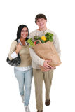 Smiling Young Couple with Groceries Shopping Royalty Free Stock Photos