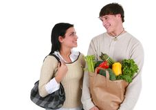Smiling Young Couple with Groceries Shopping Royalty Free Stock Images