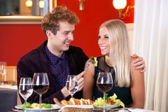 Smiling Young Couple - Guy Feeding His Partner Royalty Free Stock Photo
