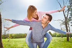 Smiling Young Couple Have A Fan Outdoor In Spring Park Royalty Free Stock Photography