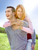 Smiling young couple have a fan Stock Photo