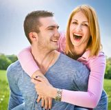 Smiling young couple have a fan in spring park Stock Photo