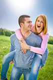 Smiling young couple have a fan in spring park Royalty Free Stock Images