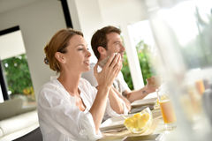 Smiling young couple having breakfast Royalty Free Stock Image