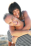 Smiling young couple having fun at the beach Royalty Free Stock Photos