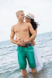Smiling young couple having fun in summer holiday Stock Photos