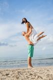 Smiling young couple having fun in summer holiday Stock Image