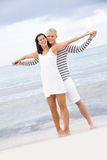 Smiling young couple having fun in summer holiday Royalty Free Stock Image