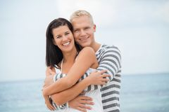 Smiling young couple having fun in summer holiday Stock Photo