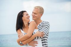 Smiling young couple having fun in summer holiday Royalty Free Stock Photography